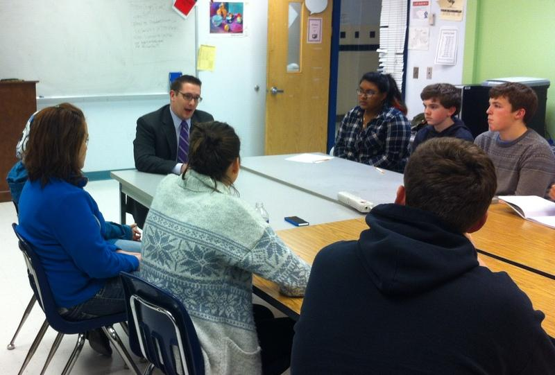 Principal Alex Case meets with the staff of The Wire to discuss potential policy changes.