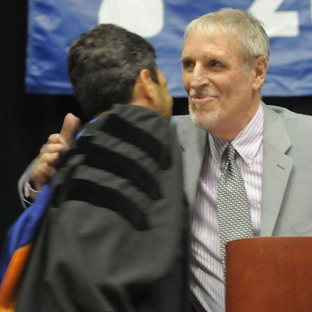 Paul Russell congratulated by former student Delegate Scott Surovell  after his retirement speech at West Potomac's 2013 commencement.