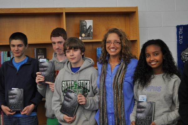 Author Elle Cosimano with several WPHS students who won raffled copies of her novel.