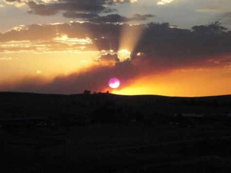 The sun sets over Wounded Knee, SD, near the Pine Ridge Reservation.