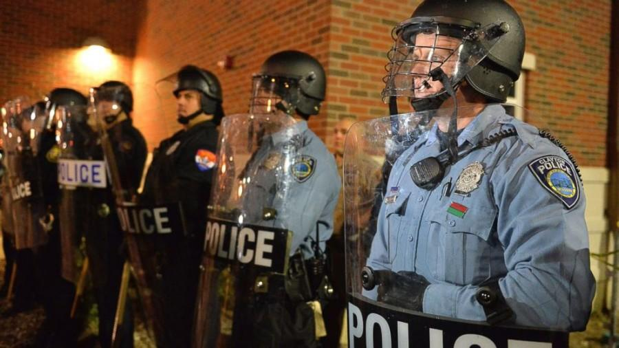 (Courtesy ABC News) Ferguson police officers in riot gear during one of many protests following the death of teenager Michael Brown.