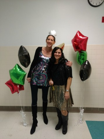 Spanish teachers Andrea Veltman and Yamalie Colon show their school spirit in sparkly attire.