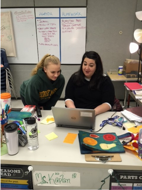 English teacher Rachel Kaplan assists junior and AP Lang student Madeline Day.