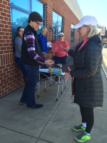 Young Republicans hand out volunteer info on Super Tuesday.