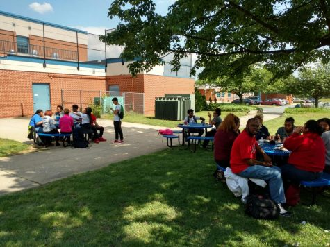Students enjoy the cookout outside near the senior lounge.
