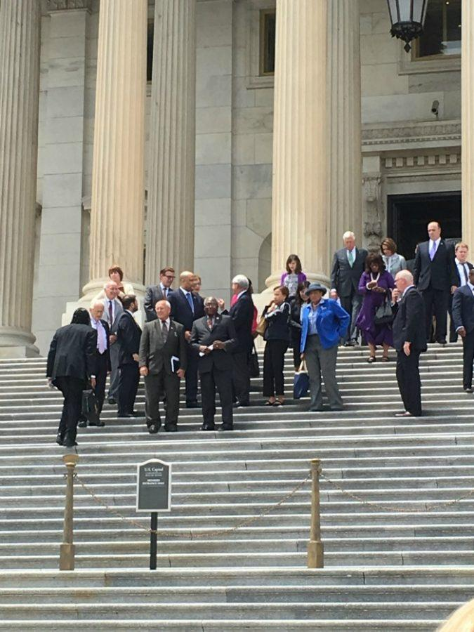 (Courtesy Emma Bass and Liz Brodie) House Democrats at the steps.