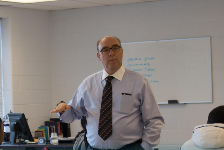 Interim Principal Dale Rumberger talking to students. (Courtesy West Potomac High School Website)