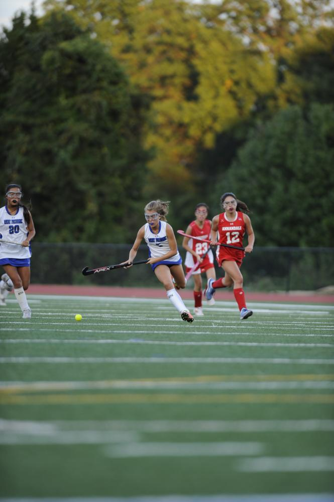 Freshman Isabella Irwin races with ball in game against Annandale.
