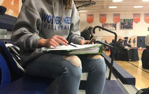 Freshman Lauren Koelsh doing homework before her JV basketball game.