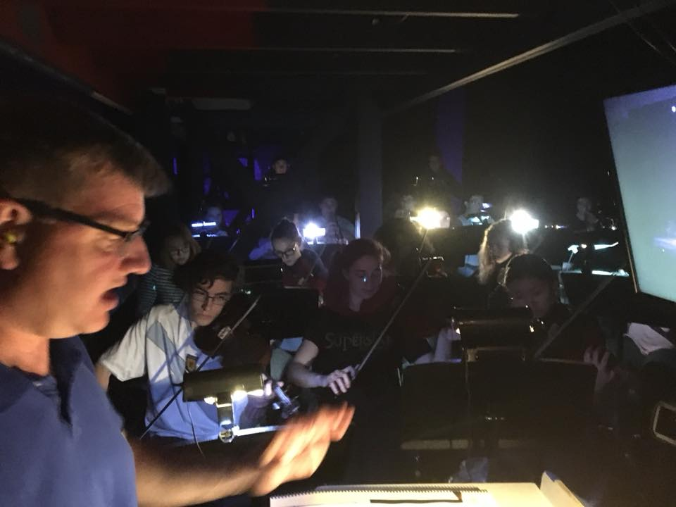 Mr. Rice directing musicians during a rehearsal.
