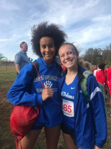 Bowman Shaughnessy (right) and Aminata Johnson (left) smiling big after Cross Country Regionals. Picture taken by Ellie Messina.