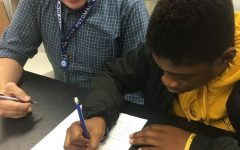 Pictured is Mr. Chapman helping a student.