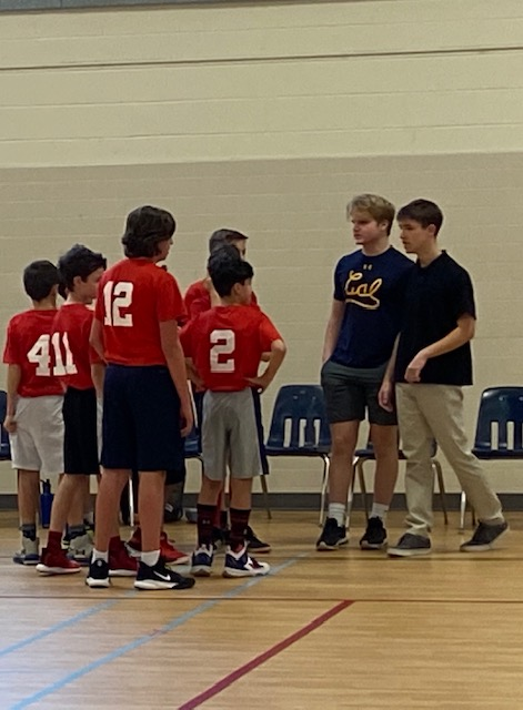 Juniors+Jake+Cooper+and+Sean+Curtin+in+team+huddle+during+game.+